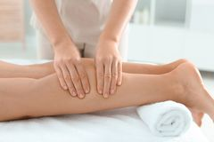 Woman receiving leg massage in wellness center. Closeup royalty free stock images