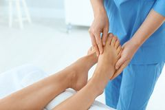 Woman receiving leg massage in wellness center. Closeup royalty free stock photo
