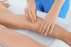 Woman receiving leg massage in wellness center,. Closeup royalty free stock photo
