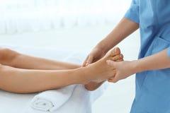 Woman receiving leg massage in wellness center,. Closeup stock photo
