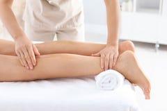 Woman receiving leg massage in wellness center. Closeup stock photos