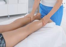 Woman receiving leg massage in wellness center,. Closeup royalty free stock photos