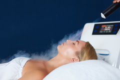 Woman receiving local cryotherapy therapy Stock Photos