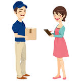 Woman Receiving Mail Package. Beautiful housewife woman receiving mail package from delivery man signing receipt Royalty Free Stock Photo