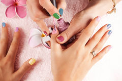 Woman receiving a manicure Royalty Free Stock Photography