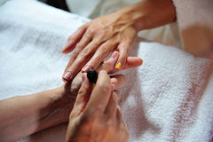 Woman receiving manicure Stock Photography