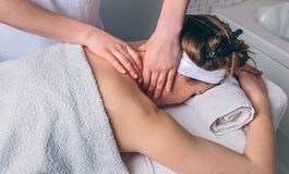 Woman receiving massage on neck in clinical center Royalty Free Stock Images