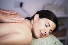 Woman receiving massage royalty free stock photography