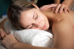 Woman receiving a massage in a spa Royalty Free Stock Photos