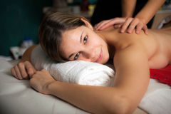 Woman receiving a massage in a spa Stock Photos