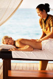 Woman receiving massage at spa resort Royalty Free Stock Image