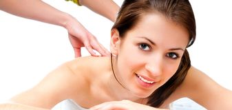 Woman receiving massage in spa salon Stock Photos