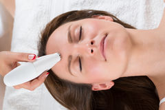 Woman Receiving Microdermabrasion Therapy Stock Images