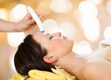 Woman receiving microdermabrasion therapy Stock Photography