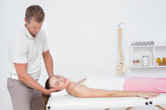 Woman receiving neck massage Royalty Free Stock Image