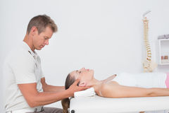 Woman receiving neck massage Royalty Free Stock Photos