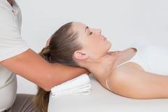 Woman receiving neck massage Stock Photo
