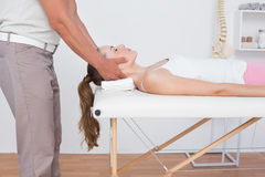 Woman receiving neck massage Royalty Free Stock Images
