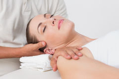 Woman receiving neck massage Royalty Free Stock Photography