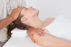 Woman receiving neck massage Stock Photography