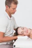 Woman receiving neck massage Stock Image
