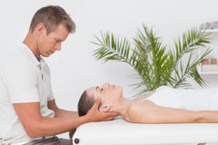 Woman receiving neck massage Royalty Free Stock Photo
