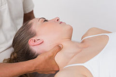 Woman receiving neck massage. In medical office stock image