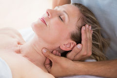 Woman receiving neck massage. In spa centre royalty free stock images