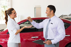 Woman receiving new car Royalty Free Stock Images