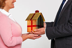 A woman receiving a new home stock images