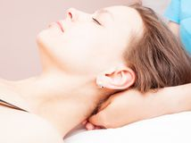 Woman receiving osteopathic treatment of her neck Royalty Free Stock Photos