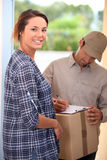 Woman receiving package Royalty Free Stock Image
