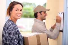 Woman receiving a package Royalty Free Stock Photo
