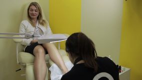 Woman receiving pedicure in nail salon stock video