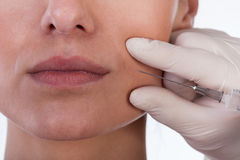 Woman receiving plastic surgery injection Stock Images