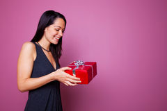Woman receiving a present Royalty Free Stock Photos
