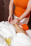 Woman receiving a professional massage and lymphatic drainage -various techniques demonstration Stock Photo