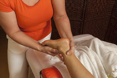 Woman receiving a professional massage and lymphatic drainage -various techniques demonstration. Woman receiving a professional therapeutic body, leg and foot Stock Image