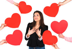 Woman receiving red hearts royalty free stock photography