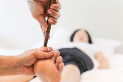 Woman receiving a Reflexology foot massage Stock Photos