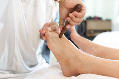 Woman receiving a Reflexology foot massage Royalty Free Stock Photography