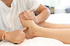 Woman receiving a Reflexology foot massage Royalty Free Stock Image