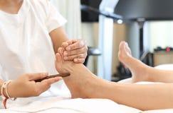 Woman receiving a Reflexology foot massage Stock Photos