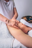 Woman receiving relaxing back massage on clinical center Royalty Free Stock Images