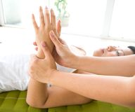 Woman receiving a relaxing hand massage Royalty Free Stock Photography