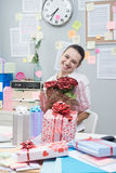 Woman receiving a romantic surprise at work. Royalty Free Stock Photo