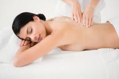 Woman receiving a salt scrub massage Royalty Free Stock Image