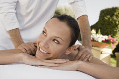 Woman Receiving Shoulder Massage Royalty Free Stock Photography