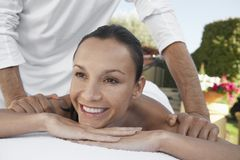 Woman Receiving Shoulder Massage And Looking Away Stock Photo