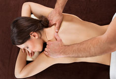 Woman Receiving Shoulder Massage At Spa Stock Image